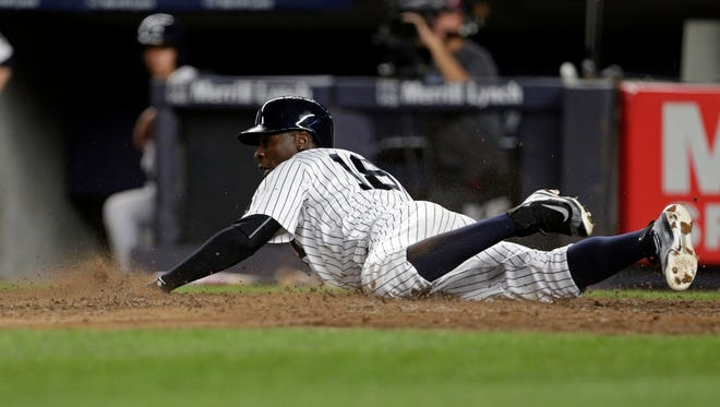 New York Yankees Didi Gregorius scores a run during the fourth inning of a baseball game against the Boston Red Sox on Sunday, July 17, 2016, in New York.