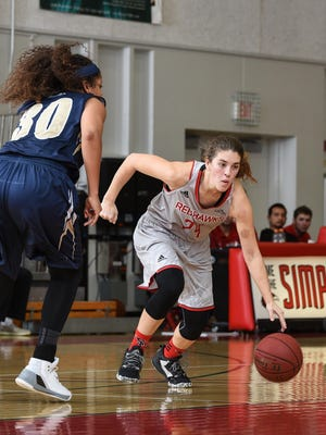 Simpson's Esther Wofford, right, controls the ball against Maritime on Saturday night. Wofford set a career scoring record in Simpson's home victory.