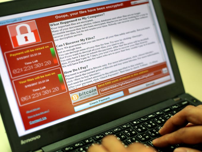 A programmer shows a sample of a ransomware cyberattack