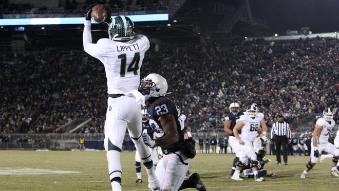 Michigan State Spartans wide receiver Tony Lippett (14) catches a pass in the end zone for a touchdown as Penn State Nittany Lions cornerback Jordan Lucas (23) defends during the third quarter at Beaver Stadium. Michigan State defeated Penn State 34-10.