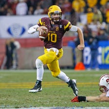 Arizona State Sun Devils quarterback Taylor Kelly (10) on the run against Stanford in the 4th quarter of their PAC-12 Championship game Saturday,  Dec. 7, 2013 in Tempe.