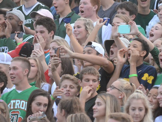 Novi's student section chants Robby Heil's name and