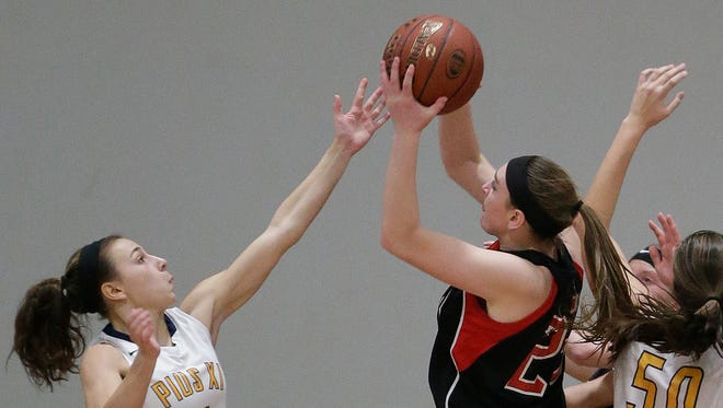 Pewaukee 's MacKenzie Schill  (right) continues to lead Pewaukee.