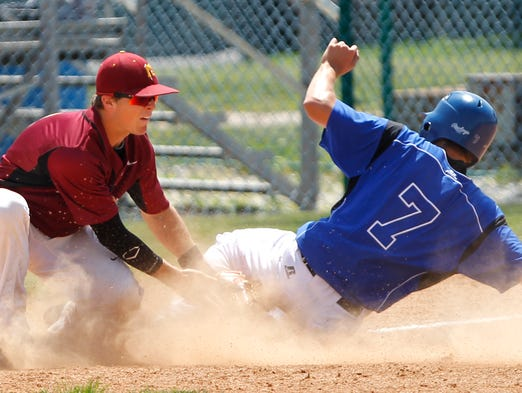 Cameron Kohli of Ft. Wayne Carroll slides safely into third beneath the tag of McCutcheon's Walter Talcott in the top of the fourth inning in the Class 4A baseball regional Saturday, June 7, 2014, at Loeb Stadium. McCutcheon lost to Ft. Wayne Carroll 5-1.