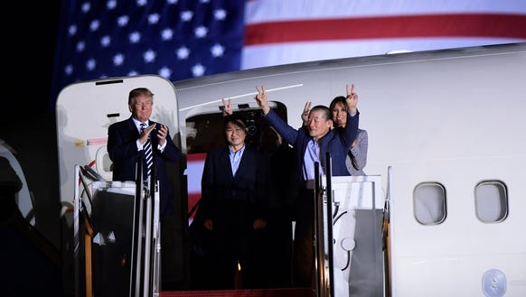President Trump, from left, greets Tony Kim, Kim Hak
