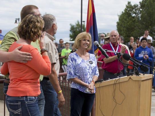 Marsha Mueller speaks during the grand opening of Kayla's