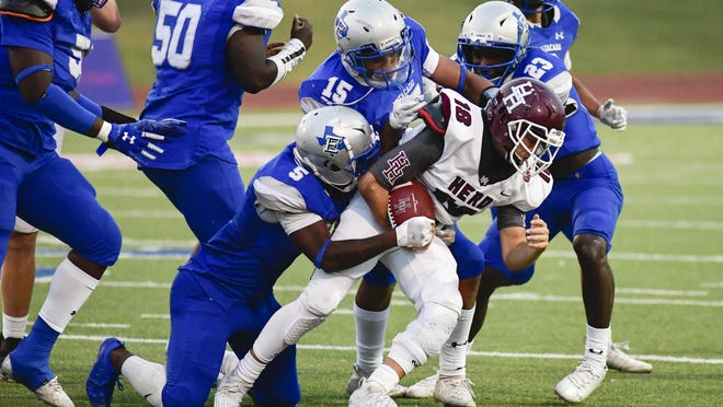 Hereford's Bryson Lopez (18) is swarmed by Estacado defenders on Friday, Sept. 18 2020, at Plains Capital Park at Lowery Field in Lubbock, Texas.