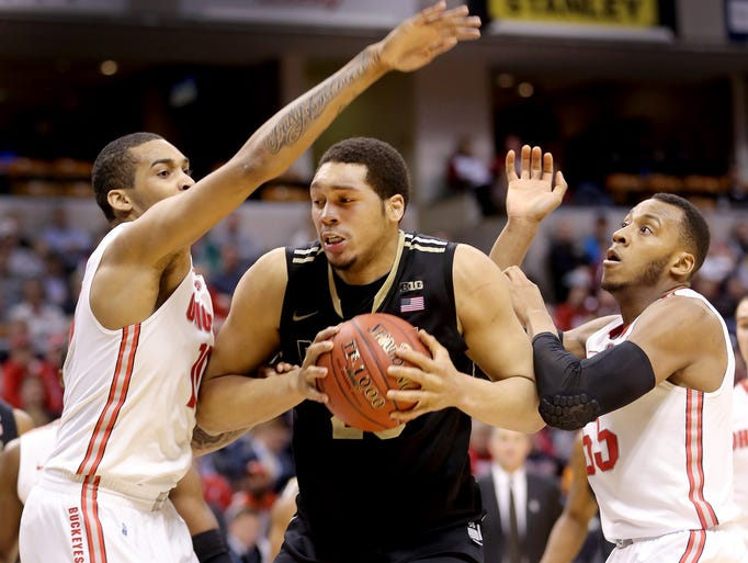 PurdueÕs A.J. Hammons is double-teamed by Ohio StateÕs LaQuinton Ross,left, and Trey McDonald,right, in the second half of game during the Big Ten Men's Basketball Tournament Thursday, March 13, 2014, at Bankers Life Fieldhouse.