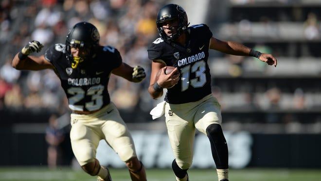 Colorado quarterback Sefo Liufau, right, ranks 13th in the nation in pass efficiency (179.9).