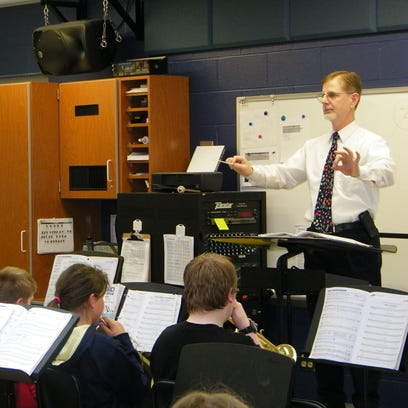 Craig McKenzie directs the sixth grade band during