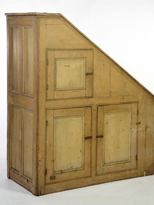 Folk-art furniture with the original paint sells for much more than a repainted, stripped, or even unpainted piece. This cupboard with original yellow on the outside and red on the inside brought $1,140 at auction, more than double the $250 to $400 estimate.