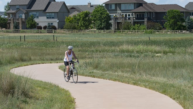 A cyclists travels near the southern terminus of bike trail in Fort Collins on Friday, June 30, 2017. Additions to the trail will connect a path for cyclists between Loveland and Fort Collins.