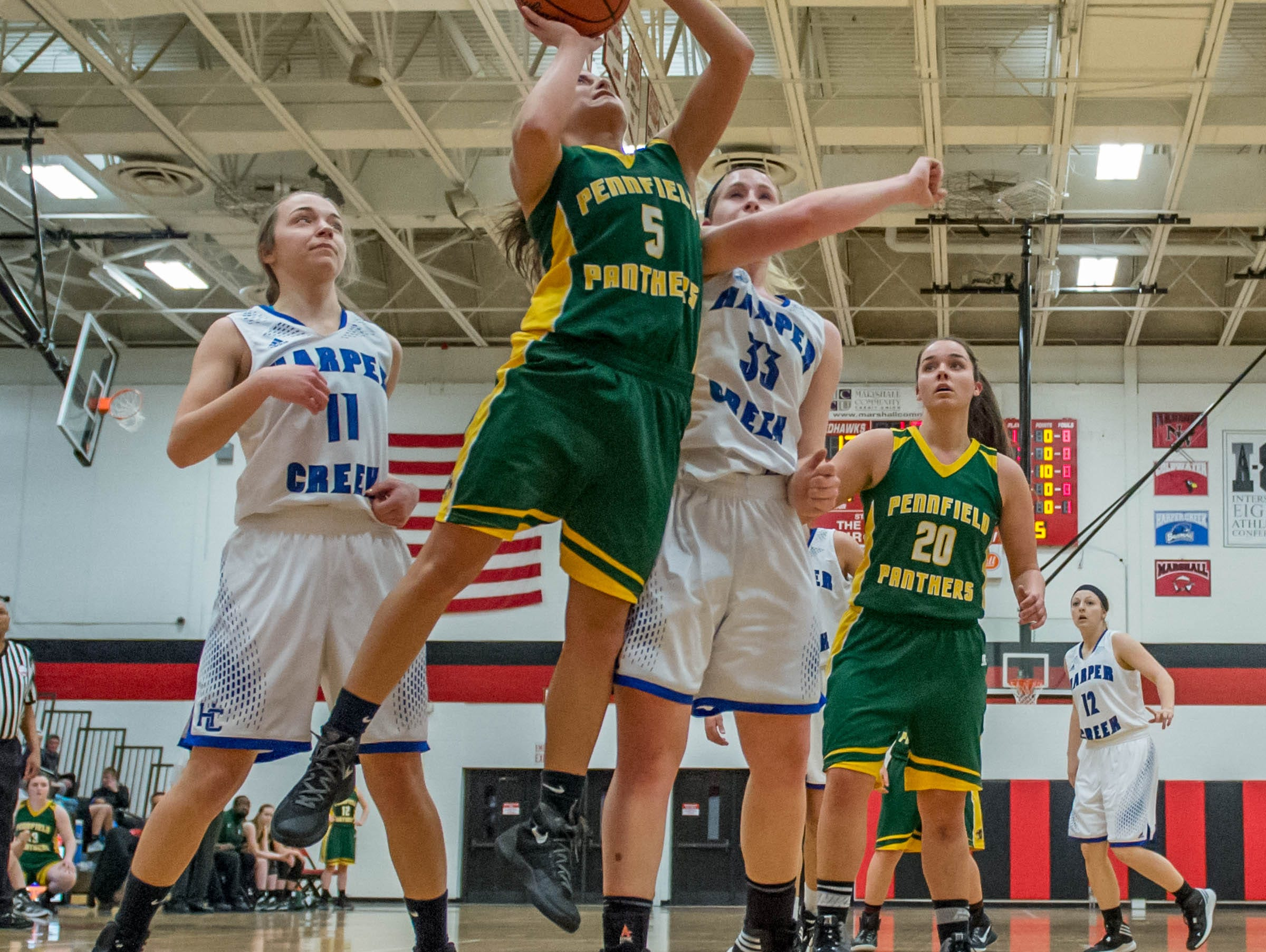 Pennfield's Jessica ROAN (5) goes for the layup in first round of districts game at Marshall Monday evening.