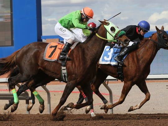Jockey Daniel Hernandez, foreground, rides Just Mary to the finish line Sunday. Just Mary is trained by Miguel Hernandez.