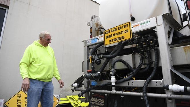 Director of Public Works Robert Scully in front of a Hawthorne Department of Public Works truck with a 9,000-gallon tank used to distribute the brine solution on the roads in preparation for ice and snow on Thursday.