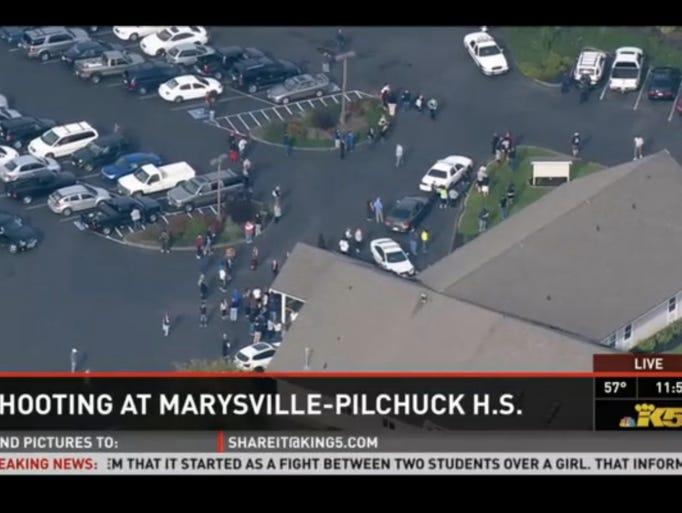 Students leave Marysville Pilchuck High School on Oct.