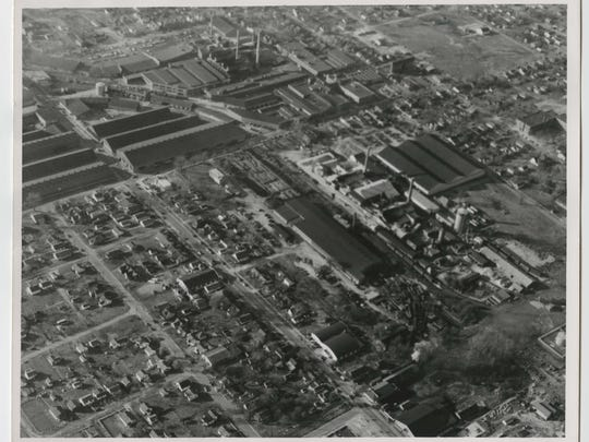 Aerial view looking southeast to northwest of the Indiana Bridge plant and Ball Brothers plant.