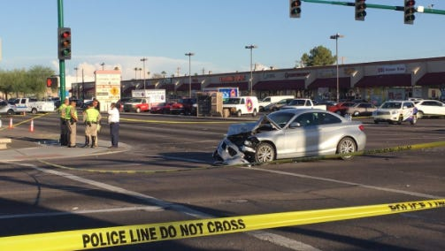 A silver BMW, suspected to have been involved in a carjacking earlier in the day, was the cause of a three-car crash after striking a DPS trooper.