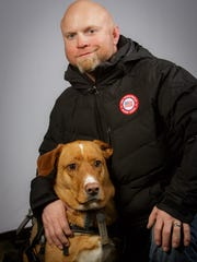 Joel Hunt, from Kokomo who has made US Paralympic team.  He is an army veteran who suffered a traumatic brain injury and partial paralysis in his leg during combat in Iraq and discovered skiing as part of his recovery.  He is with his dog Barrett.