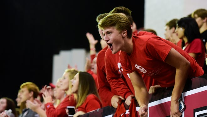 A University of South Dakota student cheers during the second half at the DakotaDome on Saturday, Oct. 7, 2017 in Vermillion, S.D.