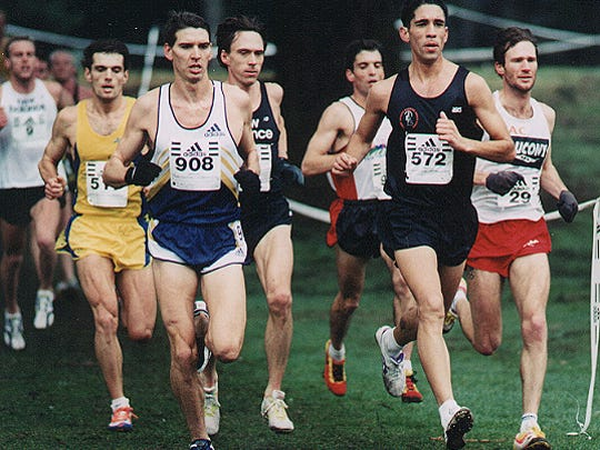 Bryan Spoonire (left, in yellow) running for the Reebok Enclave after college.