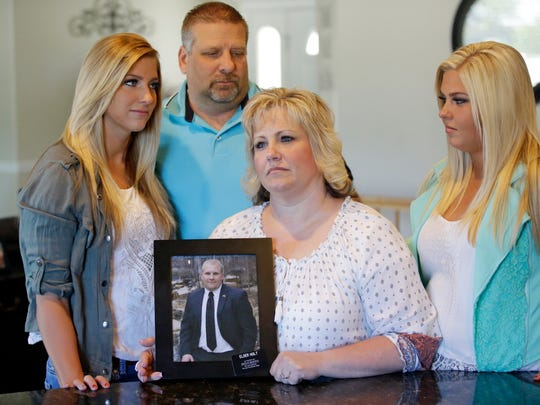 Laurie Holt holds a photograph of her son Josh Holt,