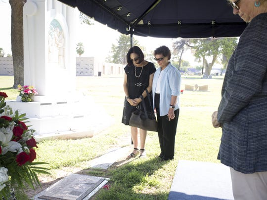 From right: Ruth Fairbanks, Bette DeGraw and Karen Scates view Gov. Rose Mofford's headstone during an unveiling ceremony Friday at St. Francis Catholic Cemetery in Phoenix.