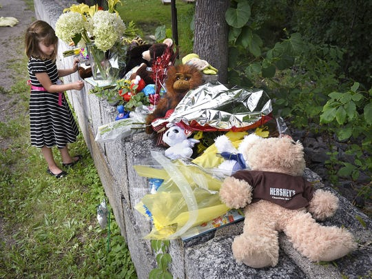 Dave Schwarz, dschwarz@stcloudtimes.com Lauren Ringsmuth looks at items Saturday placed by people as a memorial to 6-year-old Hamza Elmi near the site where his body was found in the Mississippi River Friday. Elmi was reported missing Thursday evening. The informal memorial was started Friday afternoon and by Saturday afternoon contained dozens of stuffed animals, cards, flowers and notes of sympathy. Lauren Ringsmuth looks at items Saturday placed by people as a memorial to 6-year-old Hamza Elmi near the site where his body was found in the Mississippi River Friday. Elmi was reported missing Thursday evening. The informal memorial was started Friday afternoon and by Saturday afternoon contained dozens of stuffed animals, cards, flowers and notes of sympathy.