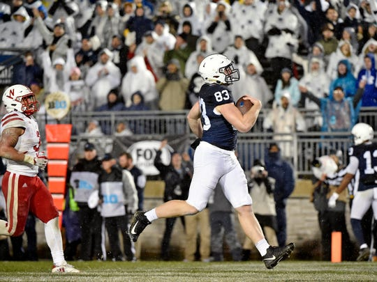 Penn State's Nick Bowers carries the ball into the end zone for a touchdown against Nebraska in the second half of an NCAA Division I football game Saturday, Nov. 18, 2017, at Beaver Stadium. Penn State defeated Nebraska 56-44 in its final home game of the 2017 season.