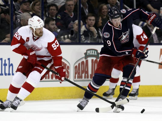 Columbus Blue Jackets' Ryan Johansen, right, works for the puck against Detroit Red Wings' Johan Franzen, of Sweden,  in the second period of an NHL hockey game in Columbus, Ohio, Tuesday, March 11, 2014. (AP Photo/Paul Vernon)
