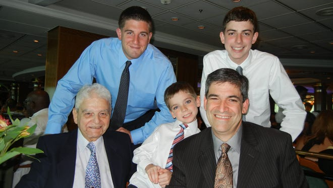"In this July 22, 2011, photo provided by Joseph Vaglio, right, shows his father Pasquale Vaglio,  left, his grandchildren Joey Vaglio, center, Michael Franza, top left and Brandon Vaglio on board the Royal Caribbean's ""Explorer of the Seas""."