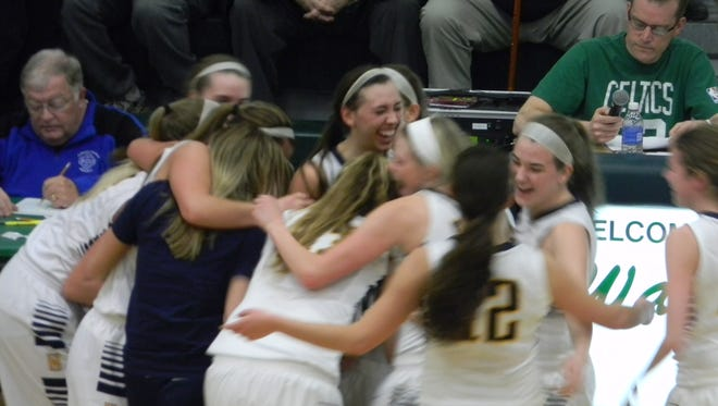 Haslett players celebrate following their 48-38 win over Grand Rapids Catholic in Wednesday's Class B quarterfinal.