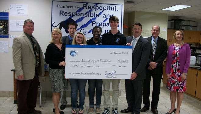 AT&T has donated $25,000 to the Brevard Schools Foundation for the Heritage High Environmental Water Technology program.