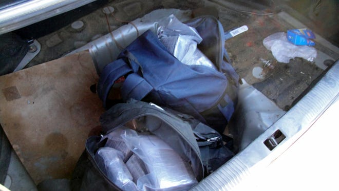 US Border Patrol agents seized bundles of marijuana concealed in backpacks in the trunk of a vehicle.
