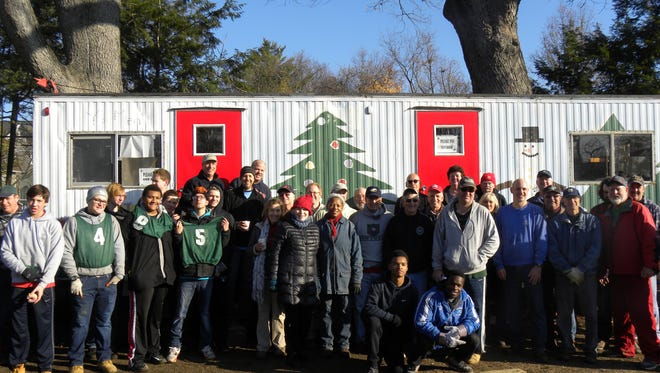 Union County Master Gardener volunteers helped the Westfield Y's Men's Club unload a shipment of 400 Fraser fir trees for their 62nd Annual Christmas tree sale.