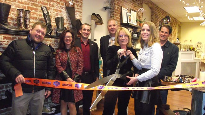 Participating in the recent grand opening of Revive in Somerville are, from left to right, Councilman Steve Peter, Downtown Somerville Alliance Executive Director Beth Anne Macdonald, Councilman Jason Kraska, Mayor Brian Gallagher, owners Cathie Golden and Brittany Burton, and Downtown Somerville Alliance Chairman Tom Genova.