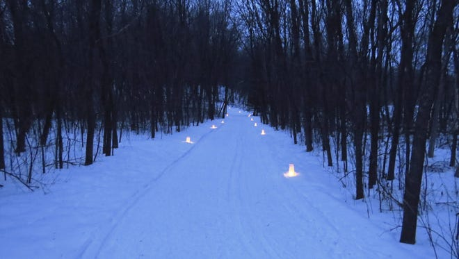 A cross-country ski trail is illuminated for a 2013 event at Robert Ney Memorial Park just north of Maple Lake.
