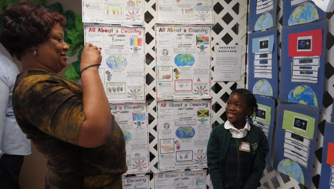 Gavrielle Alexander of North Brunswick shows her mom, Evette, one of the many displays in the Discovery Museum set up recently at The Wardlaw-Hartridge School in Edison.