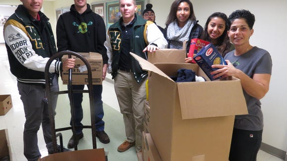 The Wardlaw-Hartridge School in Edison continued its community service outreach as Cameron Cabrera of Carteret, Brendan O'Brien of Sayreville, Mike Jesionka of Middlesex, Simu Singh of Monroe, Anisa Ahmed of Scotch Plains and Mrunali Patel of Edison join Dawn Francavilla of Somerset, Director of Student Life, in delivering items collected for Hands of Hope during the Holiday Food Drive.