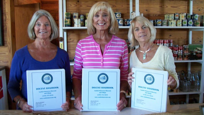 Board member Ellen O'Neill, training committee chair Gayle Pence, and volunteer Nanette Laurion are pictured.