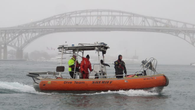 The St. Clair County Dive Team responds to a suicidal man on the Blue Water Bridge Tuesday.