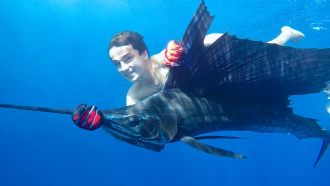 Zachary Frankel, 15, Wall, releases a sailfish during a trip to Costa Rica.
