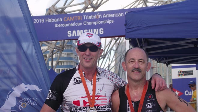 Dr. Steven Heithoff, left, and Tim Ward pose after completing the Latin American Triathlon Championships.