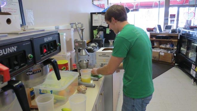 Turtle Leaf Café employee Derek Harris makes fresh lemonade.