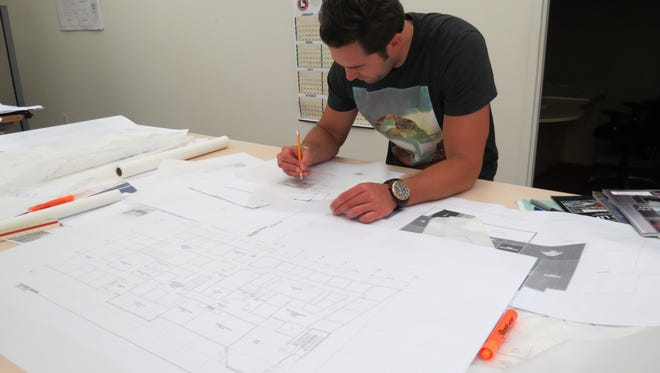 Delta architect Maxwell Bedert sketches out some ideas.