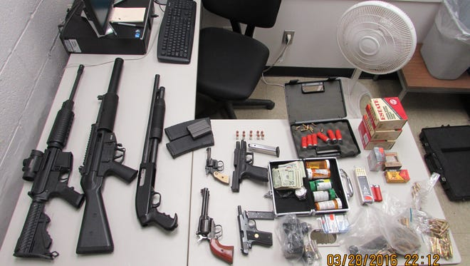Guns, ammunition and drugs confiscated Monday in a police search of a car in Ithaca.