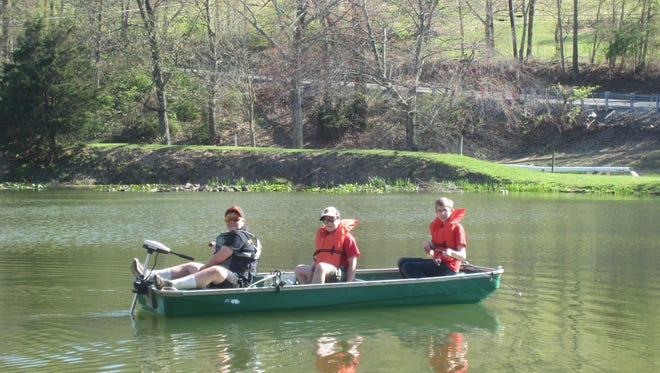 Members of Saint Joseph Boy Scout Troop 103 fishing recently at Stonewall Fish Farm in Glenville.