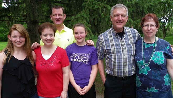 Douglas Helzerman (center right) with daughter Laura Wright and her husband Rick, granddaughters Alyssa (left) and Michala (center),  and wife Sandra (right).