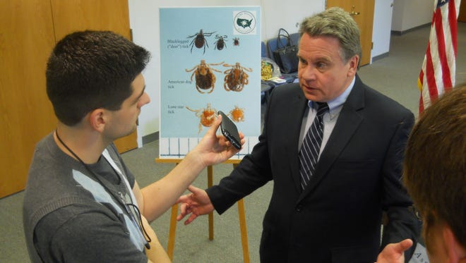 Rep. Chris Smith (right) at a Lyme disease press conference in Wall in 2013.