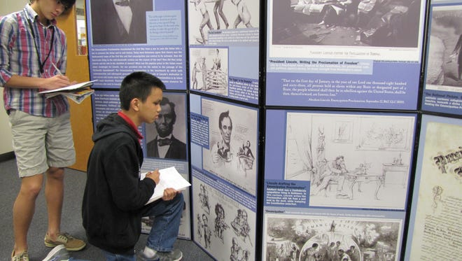 The exhibition explores the Civil War and issues of slavery through political cartoons depicting Abraham Lincoln and his policies.